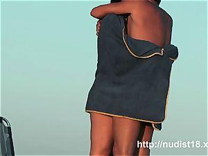 splendid nudist honeys filmed frolicking on the nude beach