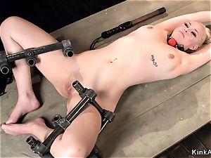 blond skinny back in metal implement bondage
