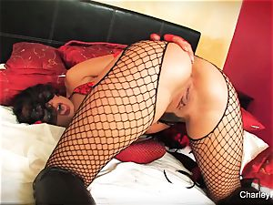 Dolled up Charley pursue plays with her poon