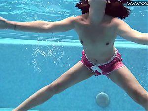 warm inked Czech beautiful in the pool