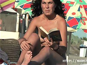A very uber-cute doll in a Spanish nudist beach